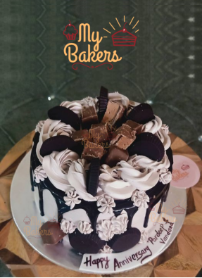 Black Forest Cake Decorated with Chocolate and Biscuits