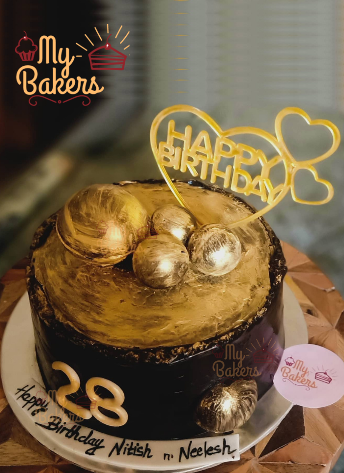 Chocolate Cake Decorated with Chocolate Layer and Golden Balls