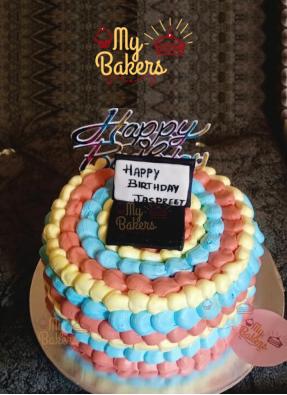 Colourful Cream Designer Cake with Edible Laptop