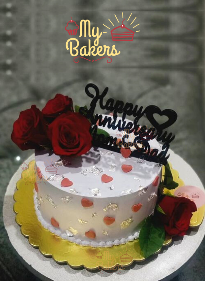 Cream Cake Decorated with Fresh Roses and Silver Foil