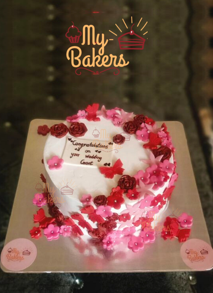 Cake Decorated with Lots of Fondant Flower and Butterfly