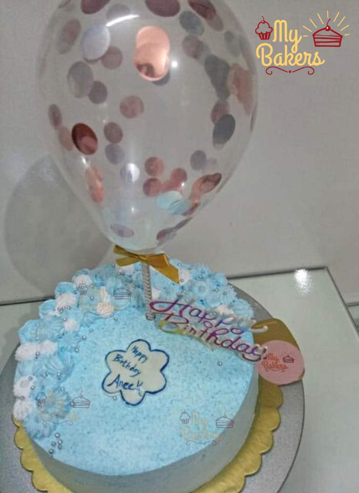 Cream Flower Cake with Silver Sprinkle Balls and Balloon Topper