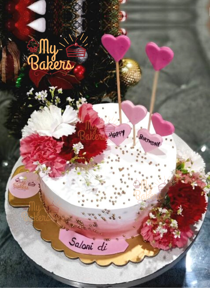 Flat Cream Cake Decorated with Golden Balls and Fresh Flowers