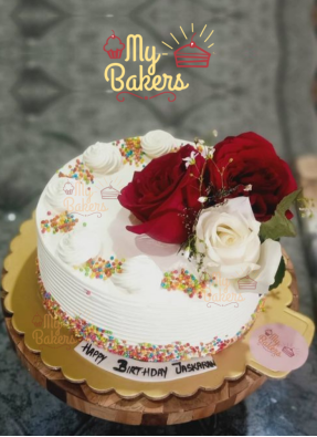 Swirl Cake Decorated with Fresh Roses and Multicolour Ball Sprinkles