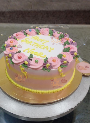 Happy Birthday Noor Cake With Flowers On Top